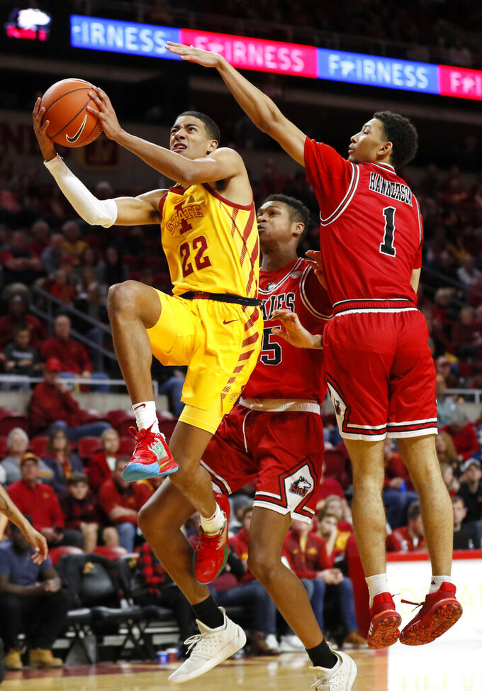 Iowa State guard Tyrese Haliburton (22) drives to the basket ahead of Northern Illinois' Nathan Scott, center, and Trendon Hankerson (1) during the second half of an NCAA college basketball game, Tuesday, Nov. 12, 2019, in Ames, Iowa. Iowa State won 70-52. (AP Photo/Charlie Neibergall)
