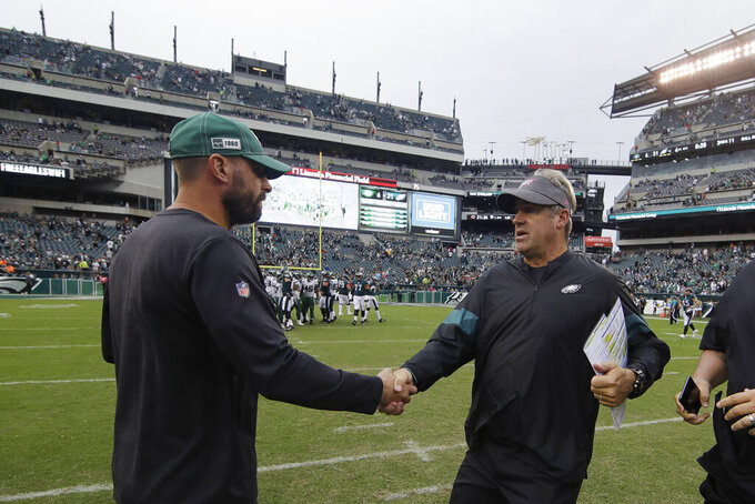 New York Jets head coach Adam Gase, left, and Philadelphia Eagles head coach Doug Pederson meet after an NFL football game, Sunday, Oct. 6, 2019, in Philadelphia. (AP Photo/Matt Rourke)