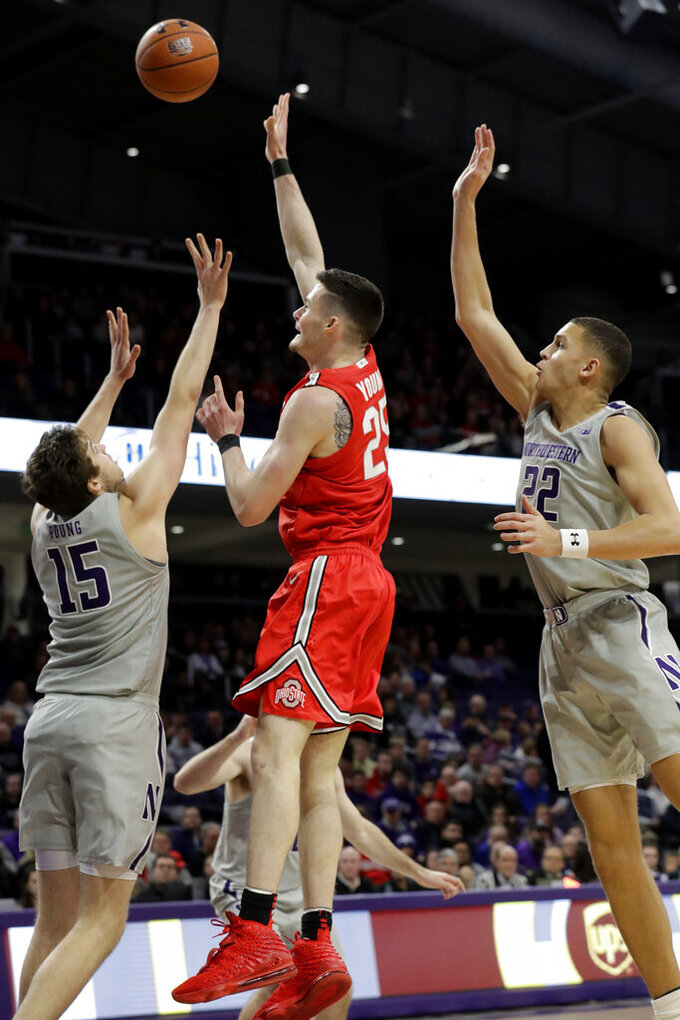 Ohio State forward Kyle Young, center, shoots against Northwestern center Ryan Young, left, and forward Pete Nance during the first half of an NCAA college basketball game in Evanston, Ill., Sunday, Jan. 26, 2020. (AP Photo/Nam Y. Huh)