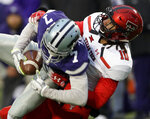 Texas Tech defensive back John Bonney (10) tackles Kansas State wide receiver Isaiah Zuber (7) during the second half of an NCAA college football game in Manhattan, Kan., Saturday, Nov. 17, 2018. (AP Photo/Orlin Wagner)