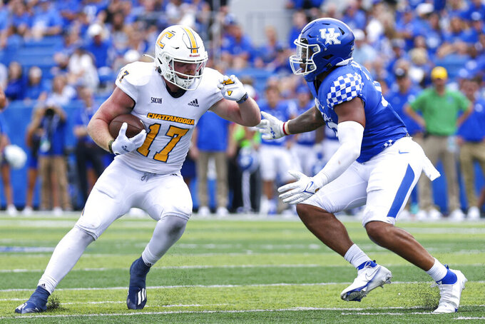 Chattanooga tight end Chris James (17) runs the ball up the field during the second half of a NCAA college football game against Kentucky in Lexington, Ky., Saturday, Sept. 18, 2021. (AP Photo/Michael Clubb)