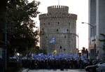 Far-right protesters take part in a rally in front of the White Tower during the annual state of the economy speech by Greece's Prime Minister Kyriakos Mitsotakis in the northern city of Thessaloniki, Greece, Saturday, Sept. 12, 2020. Mitsotakis outlined plans Saturday to upgrade the country's defense capabilities, including purchases of new fighter planes, frigates, helicopters and weapons systems, amid heightened tensions with neighboring Turkey over rights to resources in the eastern Mediterranean. (InTime News via AP)