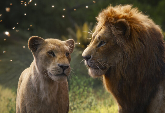 This image released by Disney shows Nala, voiced by Beyoncé Knowles-Carter, left, and Simba, voiced by Donald Glover in a scene from