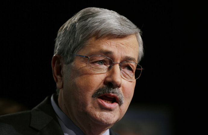 File-This Jan. 15, 2014, file photo shows then Iowa Gov. Terry Branstad making an announcement during a rally with supporters his plans to run for another term in West Des Moines, Iowa. The state of Iowa has appealed to the Iowa Supreme Court a lawsuit in which a jury concluded former Gov. Branstad discriminated against a former state official because the official is gay, Gov. Kim Reynolds said Friday, Nov. 22, 2019. A jury awarded former Iowa Workers' Compensation Commissioner Chris Godfrey $1.5 million in July, finding he was the victim of discrimination and retaliation when Branstad tried to force him to quit in 2011 and then cut his pay. Jurors found against Branstad, one of his staff members and the state. Branstad resigned as governor in 2017 to become the U.S. ambassador to China. (AP Photo/Charlie Neibergall, File)