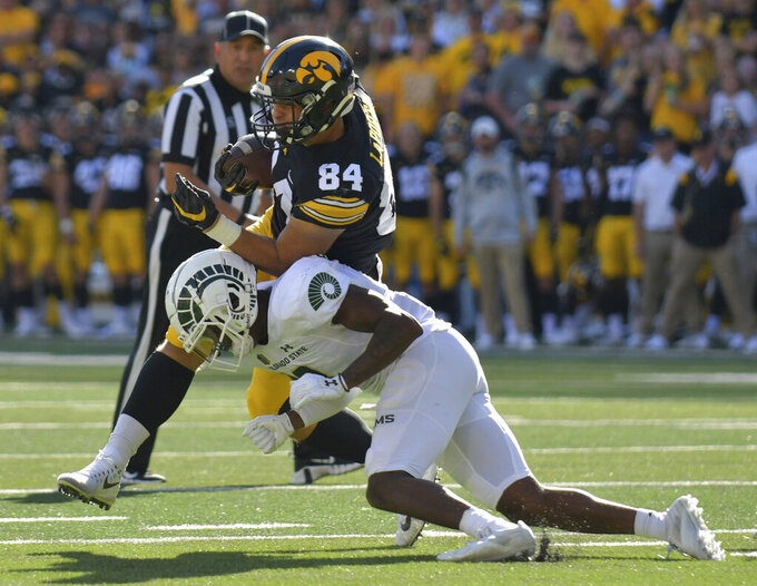 Colorado State defensive back Tywan Francis (8) tackles Iowa tight end Sam LaPorta (84) on a run after a catch during the first half of an NCAA college football game, Saturday, Sept. 25, 2021, in Iowa City, Iowa. (AP Photo/Ron Johnson)