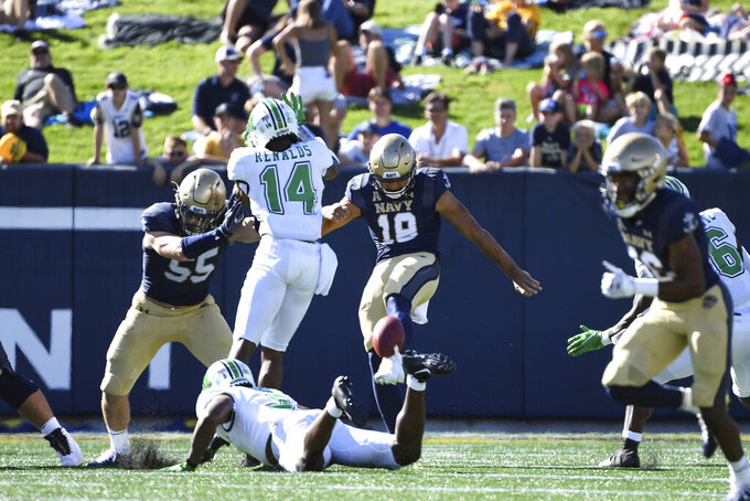 Navy punter Duke Pa'ane (18) has his punt blocked by Marshall safety Naquan Renalds (14) during the first half of an NCAA college football game, Saturday, Sept. 4, 2021, in Annapolis, Md. (AP Photo/Terrance Williams)