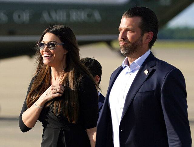 FILE - In this May 27, 2020, file photo, Donald Trump Jr., right, walks with his girlfriend, Kimberly Guilfoyle, after arriving at Andrews Air Force Base, Md., after traveling to Florida with President Donald Trump. The wife and running mate of Republican governor candidate Greg Gianforte, as well as several other top GOP officials, were exposed to the coronavirus after attending an event with Guilfoyle, the Bozeman Daily Chronicle reported. Guilfoyle was diagnosed with the coronavirus on July 3, the New York Times reported. (AP Photo/Evan Vucci, File)