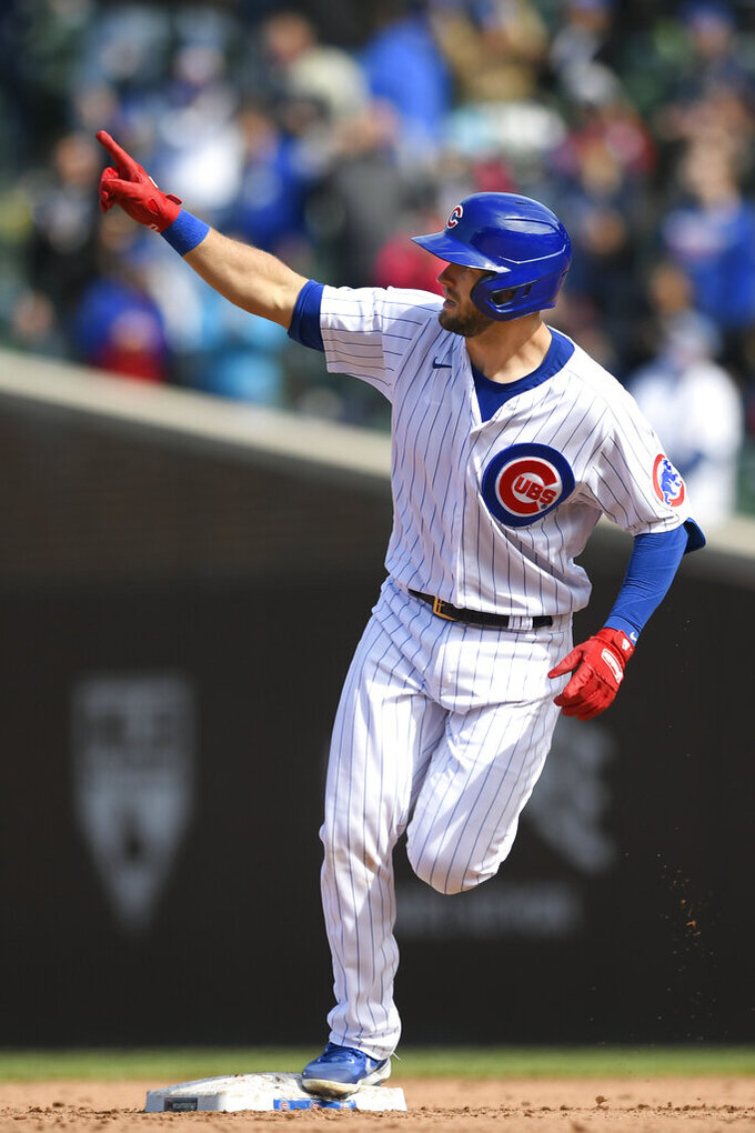 Chicago Cubs' David Bote celebrates while rounding second base after hitting a three-run home run during the fifth inning of a baseball game against the Atlanta Braves Saturday, April 17, 2021, in Chicago. (AP Photo/Paul Beaty)