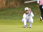 Jin Young Ko, of South Korea, lines up a putt on the 13th hole during the final round of the LPGA Cambia Portland Classic golf tournament in West Linn, Ore., Sunday, Sept. 19, 2021. (AP Photo/Steve Dipaola)