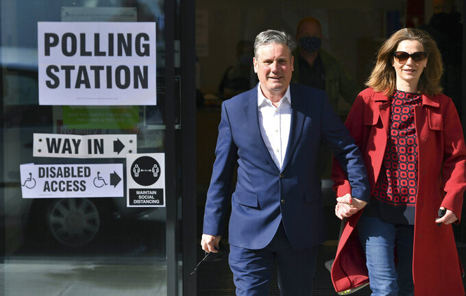 Labour leader Sir Keir Starmer and his wife Victoria leave after casting their vote  in the local and London Mayoral election, at Greenwood Centre polling station, in London,, Thursday May 6, 2021. Millions of people across Britain will cast a ballot on Thursday, in local elections, the biggest set of votes since the 2019 general election. A Westminster special-election is also taking place in Hartlepool, England. (Dominic Lipinski/PA via AP)