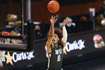 Washington State's Isaac Bonton (10) shoots against Oregon State during the first half of an NCAA college basketball game in Corvallis, Ore., Saturday, Feb. 6, 2021. (AP Photo/Amanda Loman)
