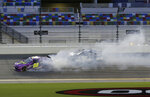 Joe Graf Jr. (08) spins as Caesar Bacarella (90) drives by during a NASCAR Xfinity auto race at Daytona International Speedway, Friday, Aug. 28, 2020, in Daytona Beach, Fla. (AP Photo/Terry Renna)