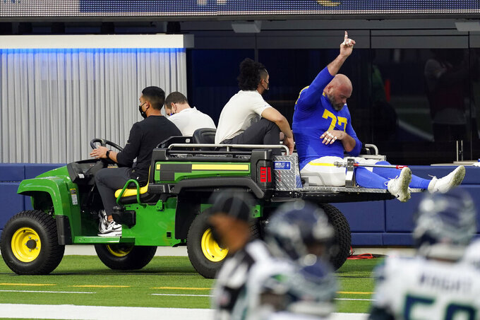 Los Angeles Rams offensive tackle Andrew Whitworth reacts as he leaves the game with an injury during the second half of an NFL football game Sunday, Nov. 15, 2020, in Inglewood, Calif. (AP Photo/Ashley Landis)