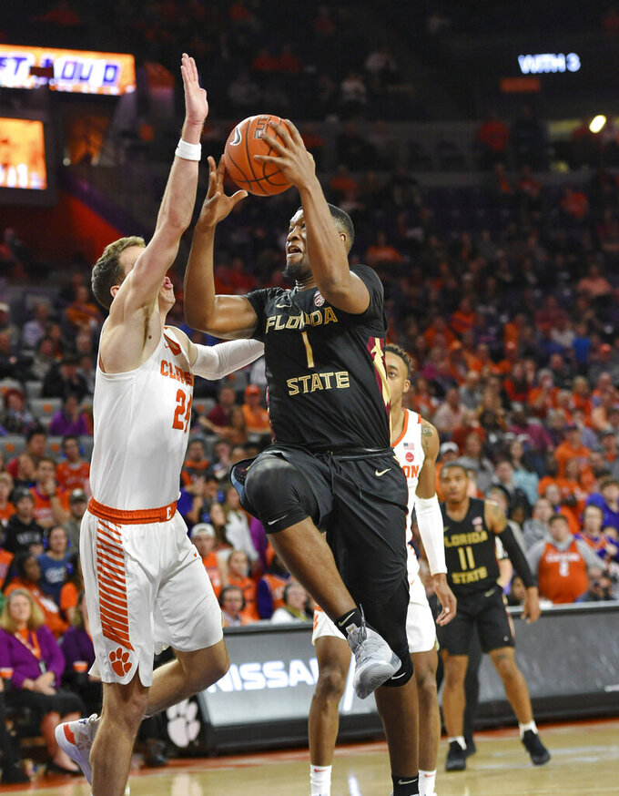 Florida State's RaiQuan Gray, right, drives to the basket while defended by Clemson's David Skara, left, during the first half of an NCAA college basketball game Tuesday, Feb. 19, 2019, in Clemson, S.C. (AP Photo/Richard Shiro)
