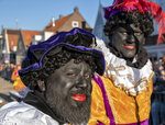 FILE - In this Nov. 17, 2018, file photo, participants in the arrival of Sinterklaas, a legendary figure based on Saint Nicholas, in Monnickendam, Netherlands, dress up as Black Pete during an annual festival. The scandal surrounding Canadian Prime Minister Justin Trudeau after a yearbook photo showing him in brownface at a 2001 costume party was published is bringing attention to a practice of using darker face makeup. Scholars say white people have been using it for years to demean Latinos and other minorities. (AP Photo/Patrick Post, File)