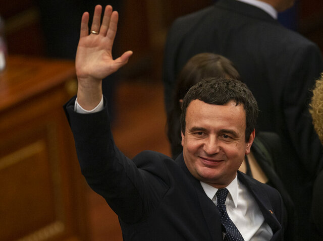 Albin Kurti, 43, newly elected prime minister of Kosovo waves after new government was elected in capital Pristina on Monday, Feb. 3, 2020.  Kosovo's parliament convened on Monday to vote in a new prime minister after four months of talks between the country's two main parties. (AP Photo/Visar Kryeziu)