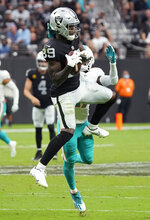 Las Vegas Raiders wide receiver Bryan Edwards (89) makes a catch against the Miami Dolphins during overtime of an NFL football game, Sunday, Sept. 26, 2021, in Las Vegas. (AP Photo/Rick Scuteri)