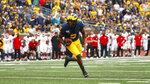 Michigan quarterback Joe Milton runs for a one-yard touchdown in the second half of an NCAA college football game against Rutgers in Ann Arbor, Mich., Saturday, Sept. 28, 2019. (AP Photo/Paul Sancya)