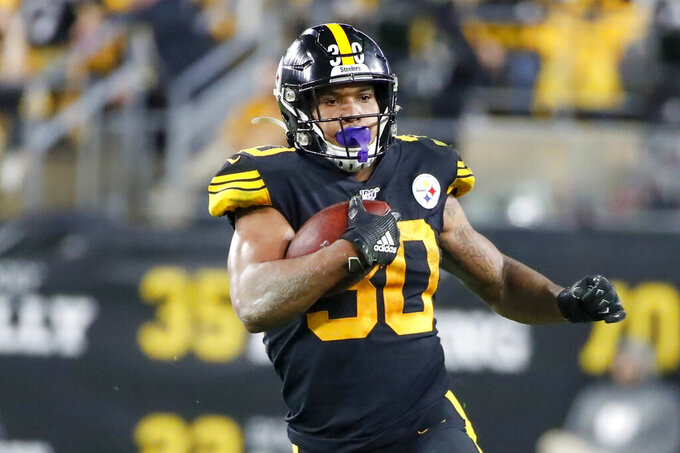 FILE - In this Oct. 28, 2019, file photo, Pittsburgh Steelers running back James Conner (30) plays against the Miami Dolphins in an NFL football game, in Pittsburgh. Conner wants to prove he can finish a season healthy. (AP Photo/Don Wright, File)
