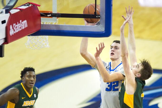 Creighton's Ryan Kalkbrenner (32) scores against North Dakota State's Grant Nelson, right, during the second half of an NCAA college basketball game in Omaha, Neb., Sunday, Nov. 29, 2020. (AP Photo/Kayla Wolf)
