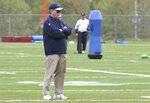 FILE — Ernie Adams, football research director for the New England Patriots, watches during NFL football practice, in Foxborough, Mass., in this Thursday, May 23, 2019 file photo. Adams, a former high school classmate of coach Bill Belichick, participated in his final practice with the team Wednesday, June 16, 2021. Adams retired from his job at the Patriots, Wednesday, June 16, after 21 years with the team. (AP Photo/Charles Krupa, File)