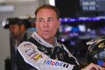 NASCAR driver Kevin Harvick looks out of his garage after he qualified for the NASCAR Brickyard 400 auto race at Indianapolis Motor Speedway, Sunday, Sept. 8, 2019, in Indianapolis. (AP Photo/AJ Mast)