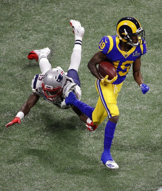 Los Angeles Rams' JoJo Natson (19) runs past New England Patriots' Keion Crossen (35) during the first half of the NFL Super Bowl 53 football game Sunday, Feb. 3, 2019, in Atlanta. (AP Photo/Charlie Riedel)