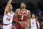 Oklahoma guard Rashard Odomes (1) drives to the basket against Mississippi forward KJ Buffen (14) during a first round men's college basketball game in the NCAA Tournament Friday, March 22, 2019, in Columbia, S.C. (AP Photo/Sean Rayford)