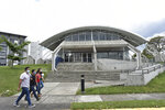 Students walks past the Solar Astronomical Observatory in San Jose, Costa Rica, Friday, April 30, 2021. Costa Rica approved a law creating a space agency on Feb. 18. (AP Photo/Carlos Gonzalez)