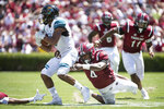 South Carolina linebacker Bryson Allen-Williams (4) wraps up Coastal Carolina wide receiver Malcolm Williams (9) during the first half of an NCAA college football game Saturday, Sept. 1, 2018, in Columbia, S.C. (AP Photo/Sean Rayford)