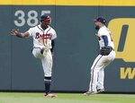 Atlanta Braves outfielders Ronald Acuna Jr., left, and Ender Inciarte react after defeating Philadelphia Phillies 5-3 in a baseball game to clinch the National League East Division, Saturday, Sept. 22, 2018, in Atlanta. (AP Photo/John Bazemore)