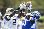 Duke's Jalon Calhoun (5) makes a catch ahead of Georgia Tech's Tariq Carpenter (2) during an NCAA college football game in Durham, N.C., Saturday, Oct. 12, 2019. (AP Photo/Ben McKeown)