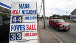 A truck passes a sign showing the lottery jackpots outside Ted's Stateline Mobil on Wednesday, June 24, 2020, in Methuen, Mass. The coronavirus pandemic has been a rollercoaster for state lotteries across the country, with some getting a boost from the economic downturn and others scrambling to make up for revenue shortfalls.  (AP Photo/Charles Krupa)