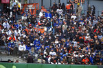 FILE - In this May 21, 2021, file photo, fans sit shoulder to shoulder in a vaccinated section of the stands during the fourth inning of a baseball game between the Los Angeles Dodgers and San Francisco Giants in San Francisco. California, the first state in America to put in place a coronavirus lockdown, is now turning a page on the pandemic. Most of California's coronavirus restrictions will disappear Tuesday, June 15, 2021. (AP Photo/D. Ross Cameron, File)