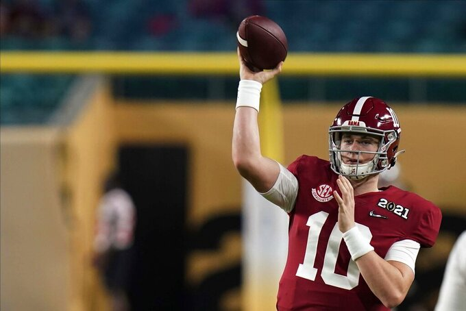 Alabama quarterback Mac Jones warms up before an NCAA College Football Playoff national championship game against Ohio State Monday, Jan. 11, 2021, in Miami Gardens, Fla. (AP Photo/Chris O'Meara)