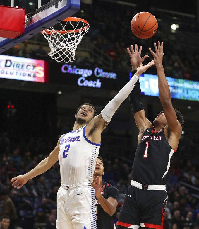DePaul forward Jaylen Butz (2) and Texas Tech guard Terrence Shannon Jr. (1) reach for a rebound during the first half of an NCAA college basketball game in Chicago on Wednesday, Dec. 4, 2019. (Chris Sweda/Chicago Tribune via AP)