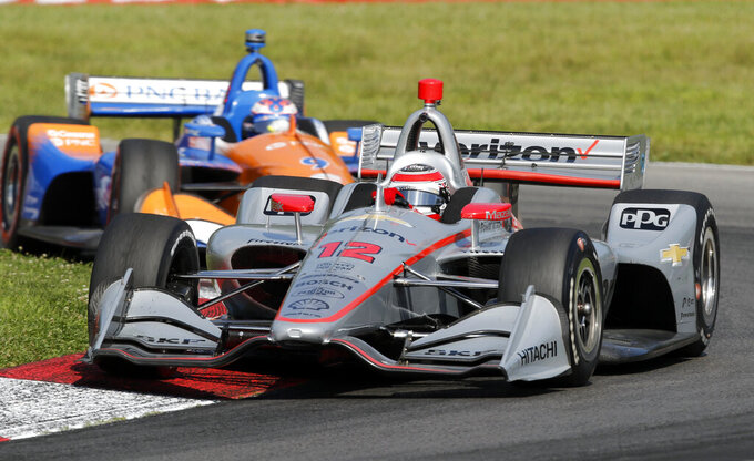 Will Power (12) leads Scott Dixon through a corner during the IndyCar Series auto race, Sunday, July 28, 2019, at Mid-Ohio Sports Car Course in Lexington, Ohio. (AP Photo/Tom E. Puskar)
