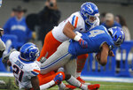 Air Force quarterback Isaiah Sanders (4) is tackled after a short gain by Boise State safety Tyreque Jones, left, and linebacker Tyson Maeva in the first half of an NCAA college football game Saturday, Oct. 27, 2018, at Air Force Academy, Colo. (AP Photo/David Zalubowski)
