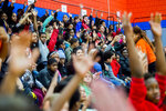 Flint students raise their hand when asked if they know what a Playstation is while Markell Baldwin, a senior engineer at Tesla, speaks during a presentation and announcement with tech billionaire Elon Musk on Friday, March 22, 2019 at Doyle-Ryder Elementary School in Flint. Musk is providing a Chromebooks for every seventh-grader in the 2019-20 school year and will provide water filtration systems to be installed in all Flint schools. (Jake May/The Flint Journal via AP)/The Flint Journal via AP)