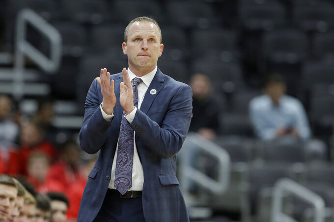 Drake head coach Darian DeVries is seen on the sidelines during the first half of an NCAA college basketball game against Illinois State in the first round of the Missouri Valley Conference men's tournament Thursday, March 5, 2020, in St. Louis. (AP Photo/Jeff Roberson)