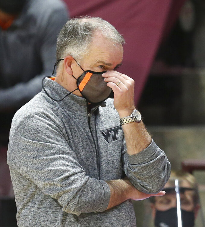 Virginia Tech head coach Mike Young looks on during the second half of an NCAA college basketball game against Penn State, Tuesday, Dec. 8, 2020 in Blacksburg Va. (Matt Gentry/The Roanoke Times via AP, Pool)