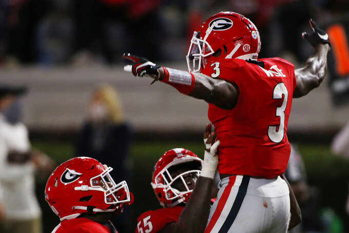 Georgia running back Zamir White (3) celebrates after scoring a touchdown during the first half of the team's NCAA college football game against Auburn in Athens, Ga., Saturday, Oct. 3, 2020. (Joshua L. Jones/Athens Banner-Herald via AP)