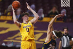 Minnesota center Liam Robbins (0) shoots over UMKC forward Josiah Allick (20) during the first half of an NCAA college basketball game Thursday, Dec. 10, 2020, in Minneapolis. (AP Photo/Stacy Bengs)