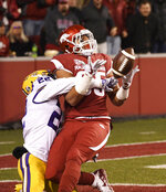LSU defender Kristian Fulton (22) breaks up a pass intended for Arkansas tight end Cheyenne O'Grady during the first half of an NCAA college football game, Saturday, Nov. 10, 2018, in Fayetteville, Ark. (AP Photo/Michael Woods)