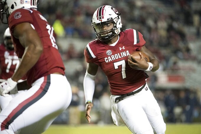 South Carolina quarterback Dakereon Joyner (7) runs with the ball during the second half of an NCAA college football game against Chattanooga Saturday, Nov. 17, 2018, in Columbia, S.C. (AP Photo/Sean Rayford)