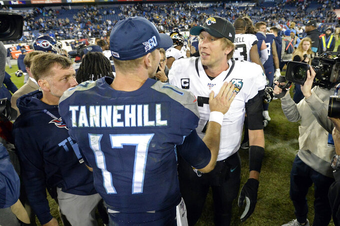 Tennessee Titans quarterback Ryan Tannehill (17) meets with Jacksonville Jaguars quarterback Nick Foles after an NFL football game Sunday, Nov. 24, 2019, in Nashville, Tenn. The Titans won 42-20. (AP Photo/Mark Zaleski)