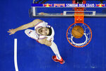 Philadelphia 76ers' Furkan Korkmaz watches his shot during the first half of an NBA basketball game against the Chicago Bulls, Sunday, Feb. 9, 2020, in Philadelphia. (AP Photo/Matt Slocum)