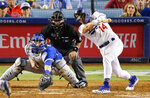 Los Angeles Dodgers' Enrique Hernandez hits a single to drive in the winning run, in front of Toronto Blue Jays catcher Danny Jansen and home plate umpire Pat Hoberg during the ninth inning of a baseball game Thursday, Aug. 22, 2019, in Los Angeles. (AP Photo/Mark J. Terrill)