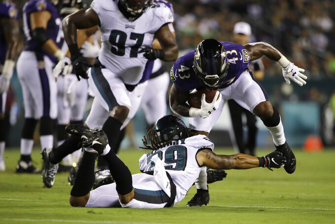 Baltimore Ravens' Justice Hill (43) tries to break free of Philadelphia Eagles' Avonte Maddox (29) during the first half of a preseason NFL football game Thursday, Aug. 22, 2019, in Philadelphia. (AP Photo/Matt Rourke)