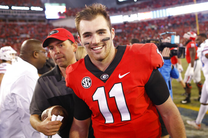 Georgia quarterback Jake Fromm (11) heads to speak with the media after getting a win in an NCAA college football game between Georgia and Florida at in Jacksonville, Fla. Saturday, Oct. 27, 2018. (Joshua L. Jones/Athens Banner-Herald via AP)